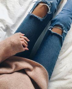 Distressed denim + cozy sweater.