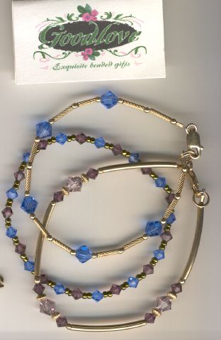Gold filled purple and blue and Swarovski crystal beaded bracelets! Deborah Goodlove