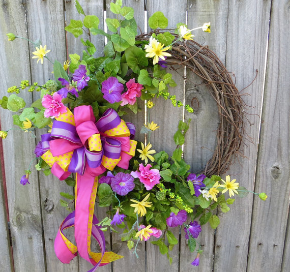 Green vines and small yellow and puple flowers combined to make this green vines and small yellow and puple flowers combined to make this wreath wonderful mightylinksfo