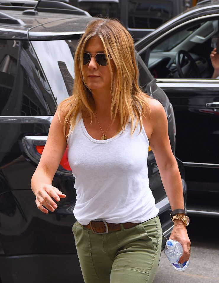 Jennifer Aniston nails casual chic as she steps out in a white vest ...