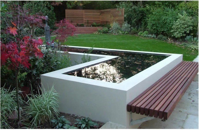Modern garden pond with decked bench seat cantilevered benches