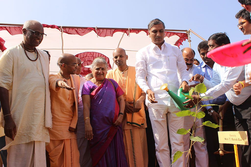 MLA Shri T Harish Rao waters a sapling planted at the site
