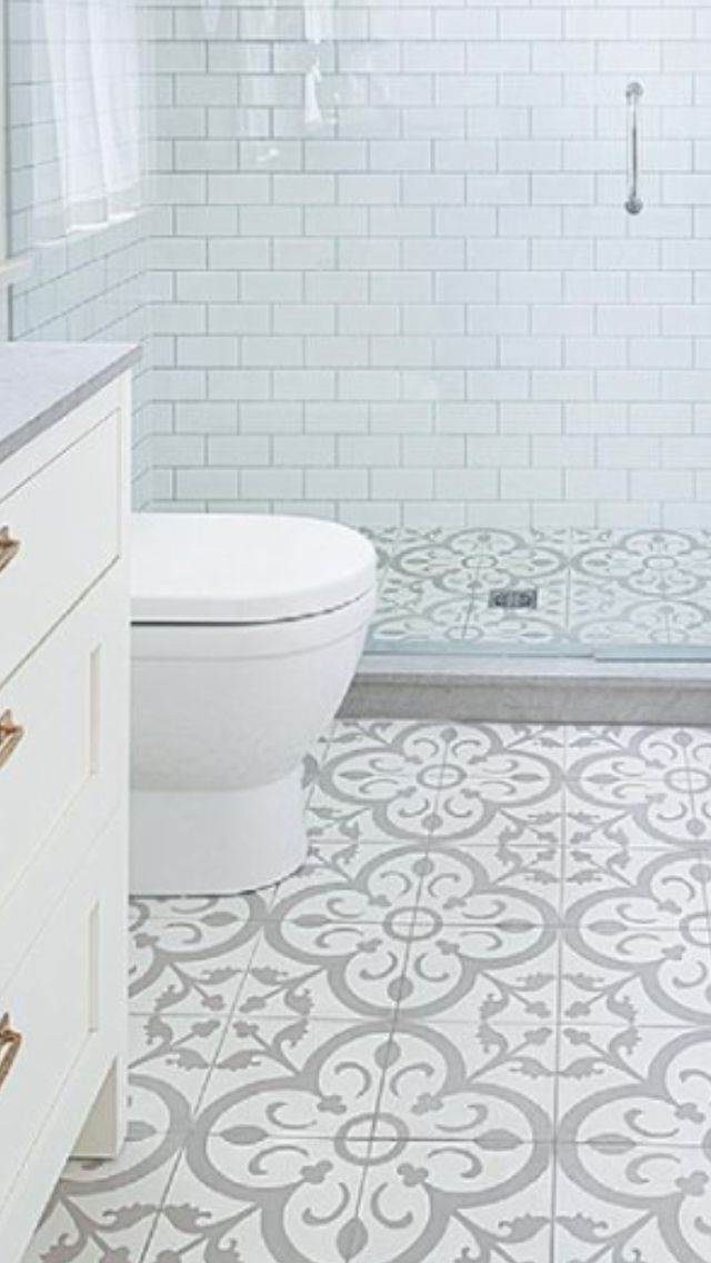Photo of Like the idea if same tile in shower & floor; also the low barrier & frameless s…