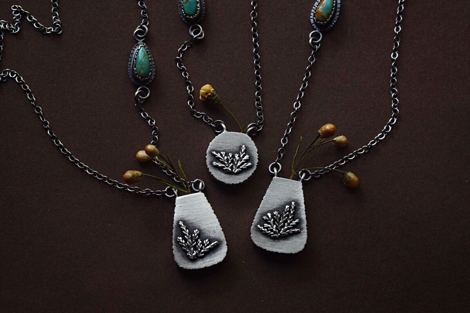 Bracelet and Earring set Necklace and Bracelet have a Silver medallion with leaf accent earring has leaves Silver Tree and leaf Necklace