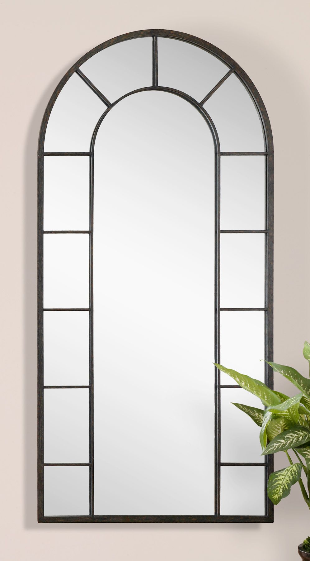 Dillingham this stately arched mirror features an aged black