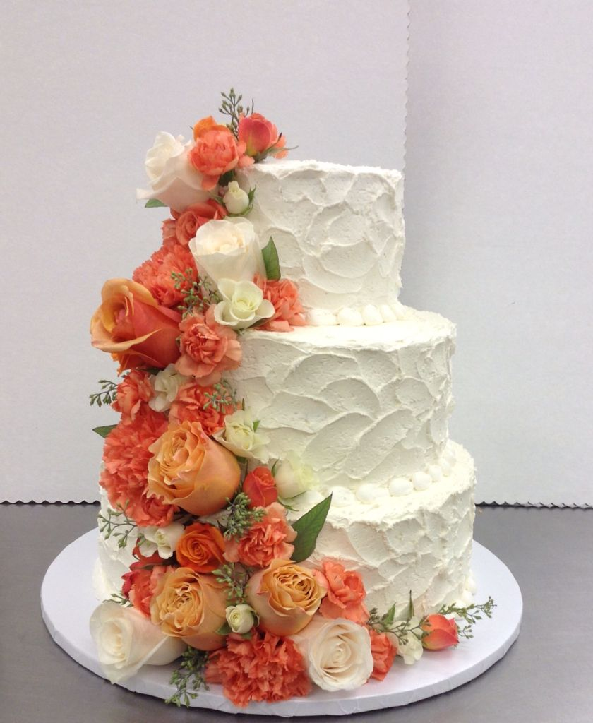 Coral, Orange And Ivory Flowers For The Wedding Cake By