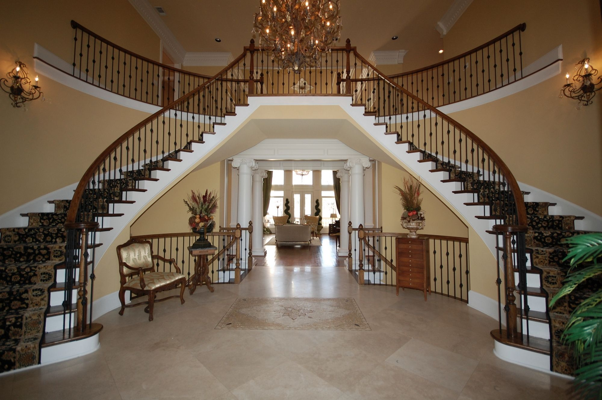 House Foyer Staircase : Love the dual staircase in entrance foyer of this