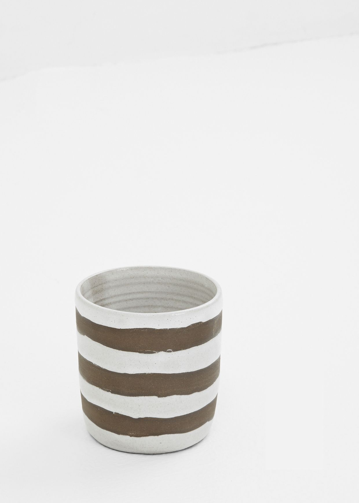 dark brown clay with white resist and white glaze white resist