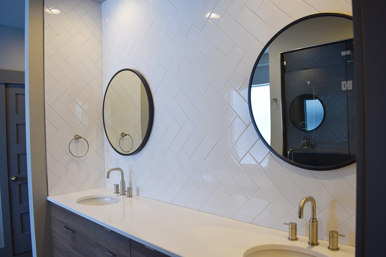 Master vanity, quartz countertop, undermount sink, herringbone tile ...
