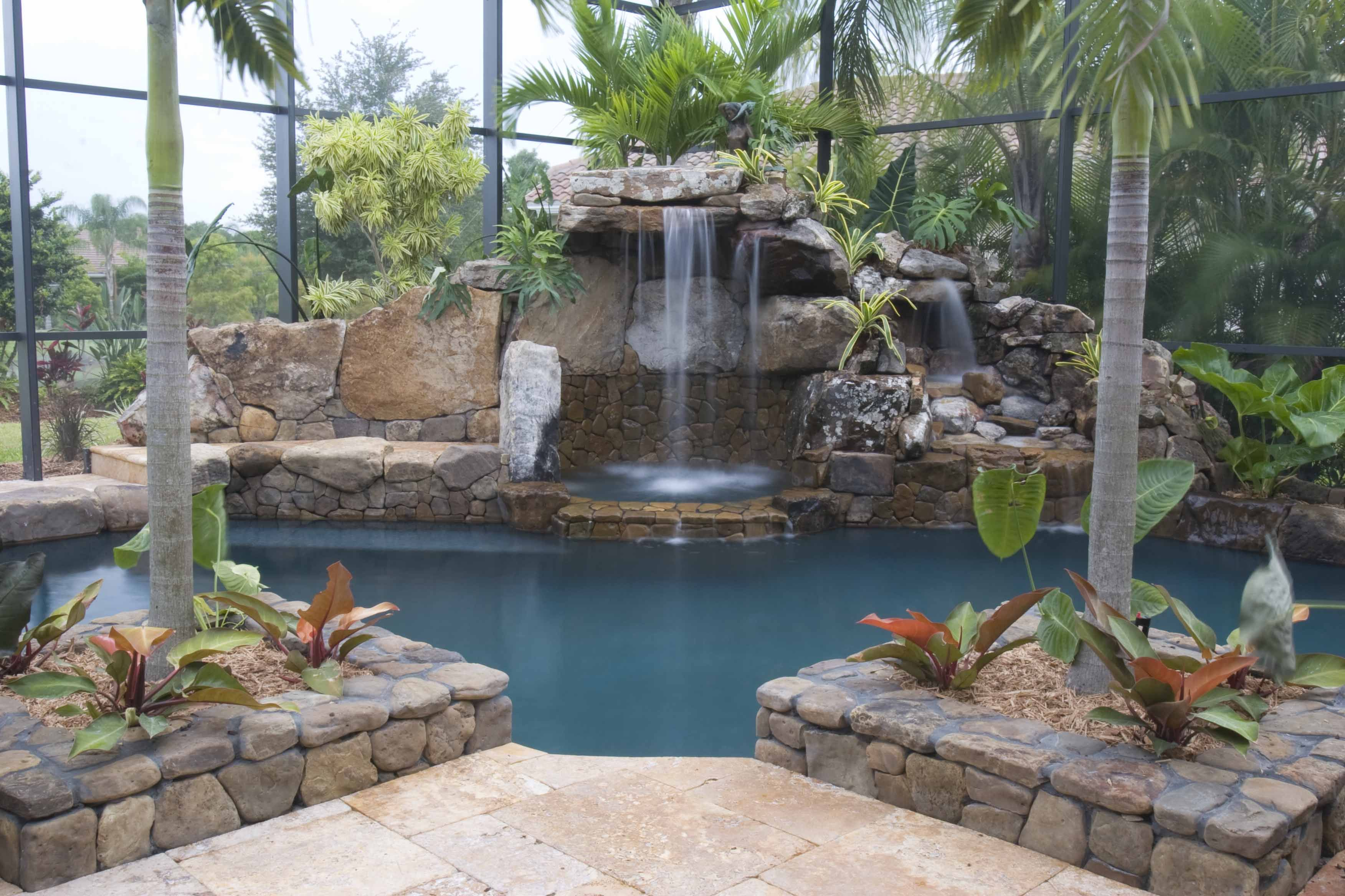 Swimming pool remodel stone grotto waterfall and spa by for Natural rock swimming pools