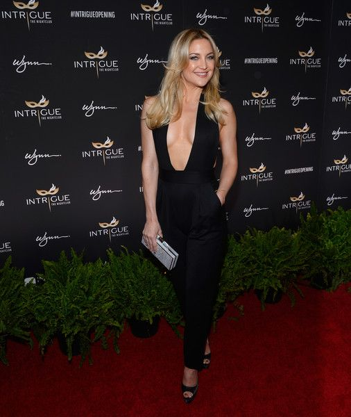 Kate Hudson Jumpsuit - Kate Hudson took a super-sexy plunge in this low-cut black jumpsuit by Milly during the Intrigue Nightclub grand opening.