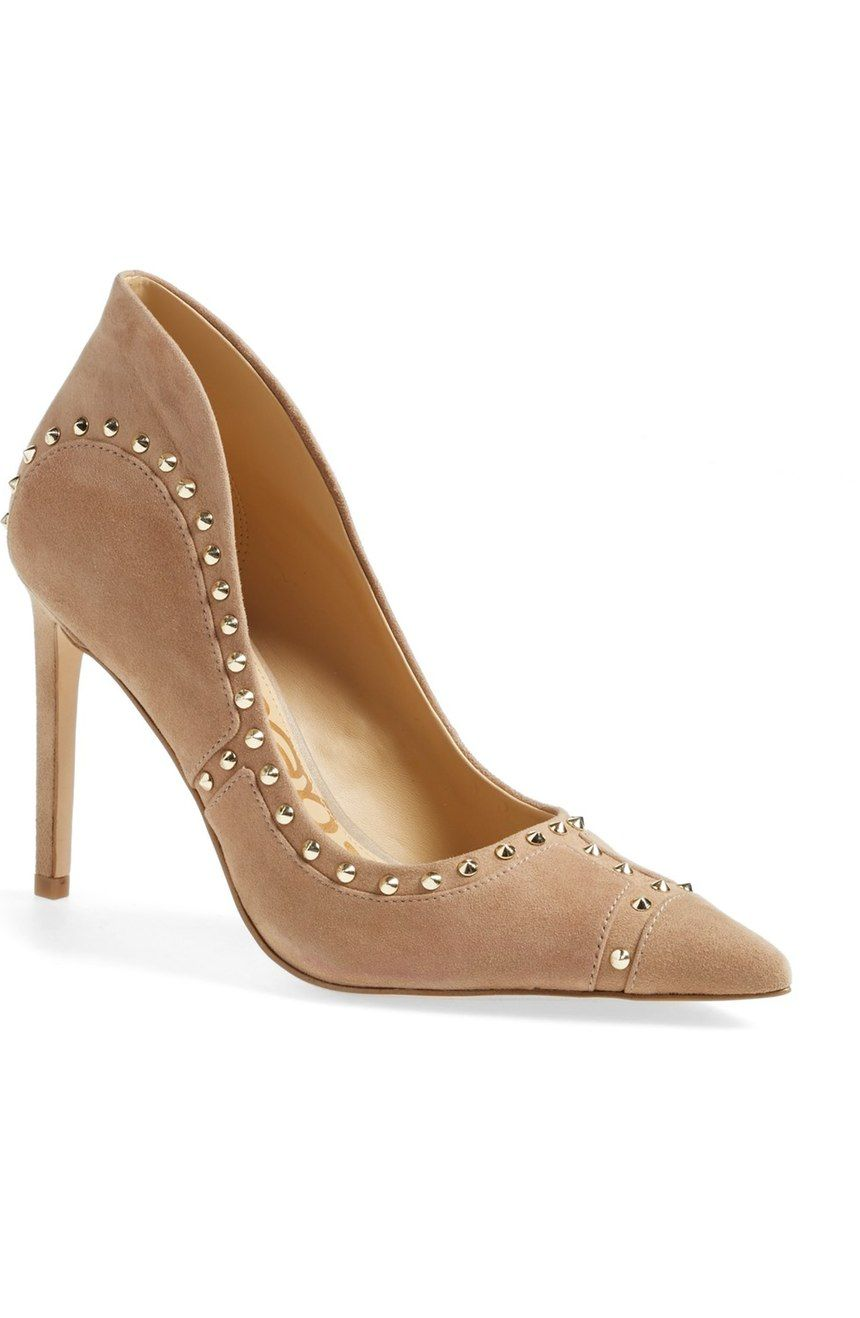 43f38c2af8e0 Gold spikes distinguish these edgy pumps in a gorgeous oatmeal suede ...