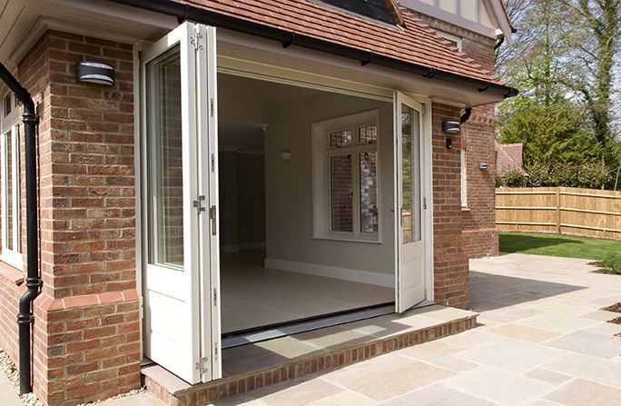 timber bifold doors, external fully open, white, by Mumford & Wood