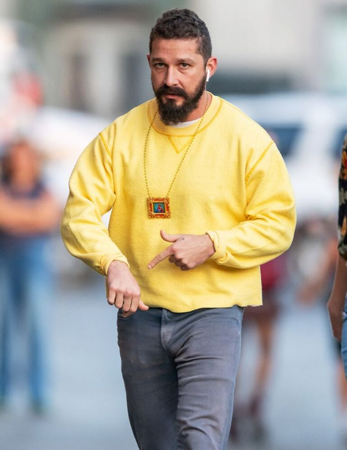 Shia LaBeouf Wears a Tiny Clown Painting Around His Neck