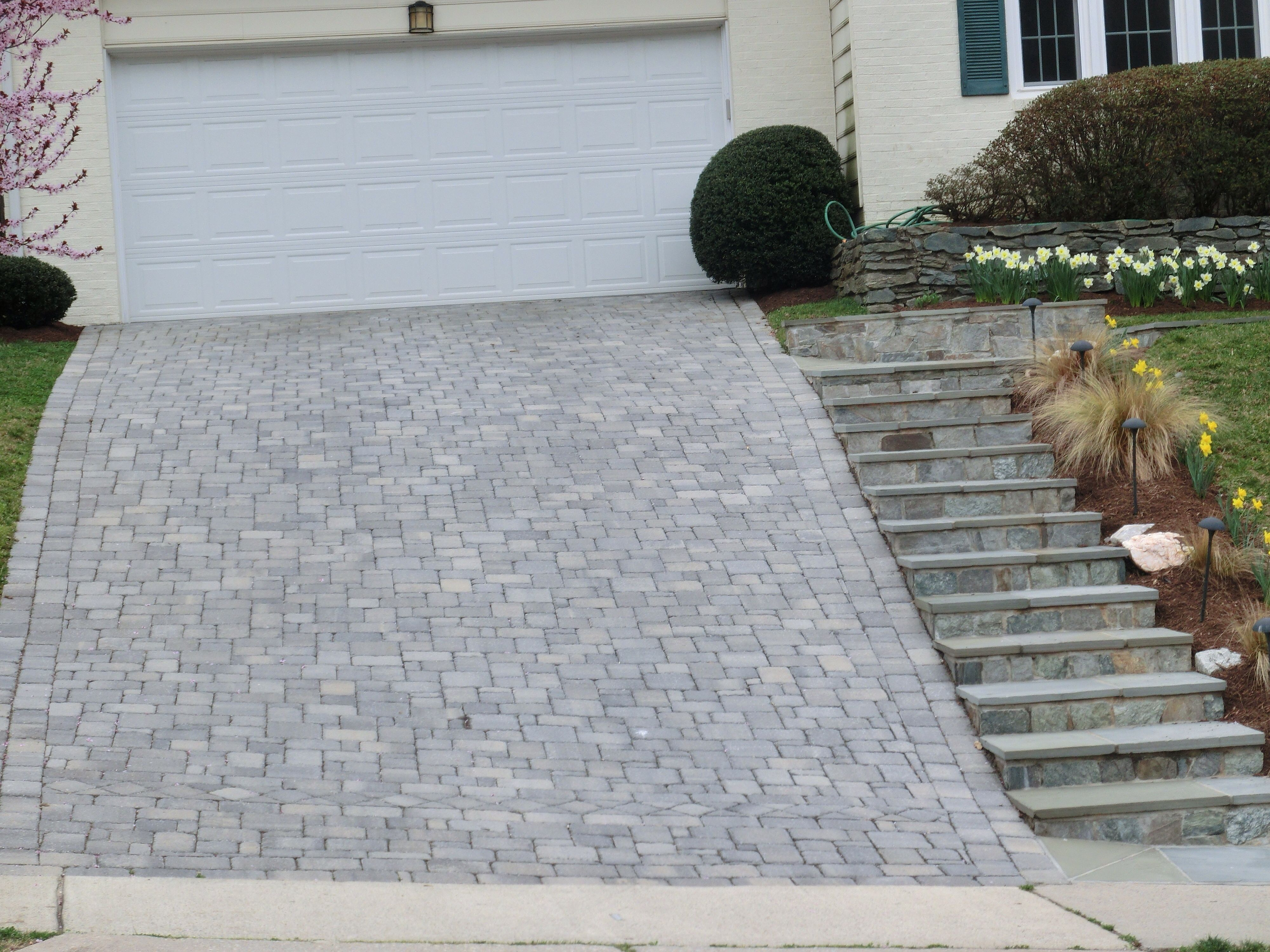 sloped paver driveway with steps