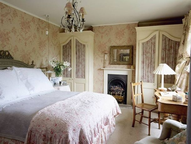 floral bedroom in Sussex with gathered fabric armoire doors
