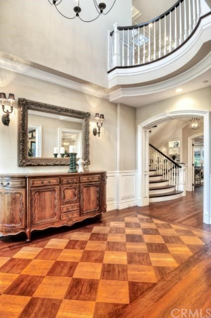 Grand Entry By Hilton Builders Checkered Wood Flooring Creates A