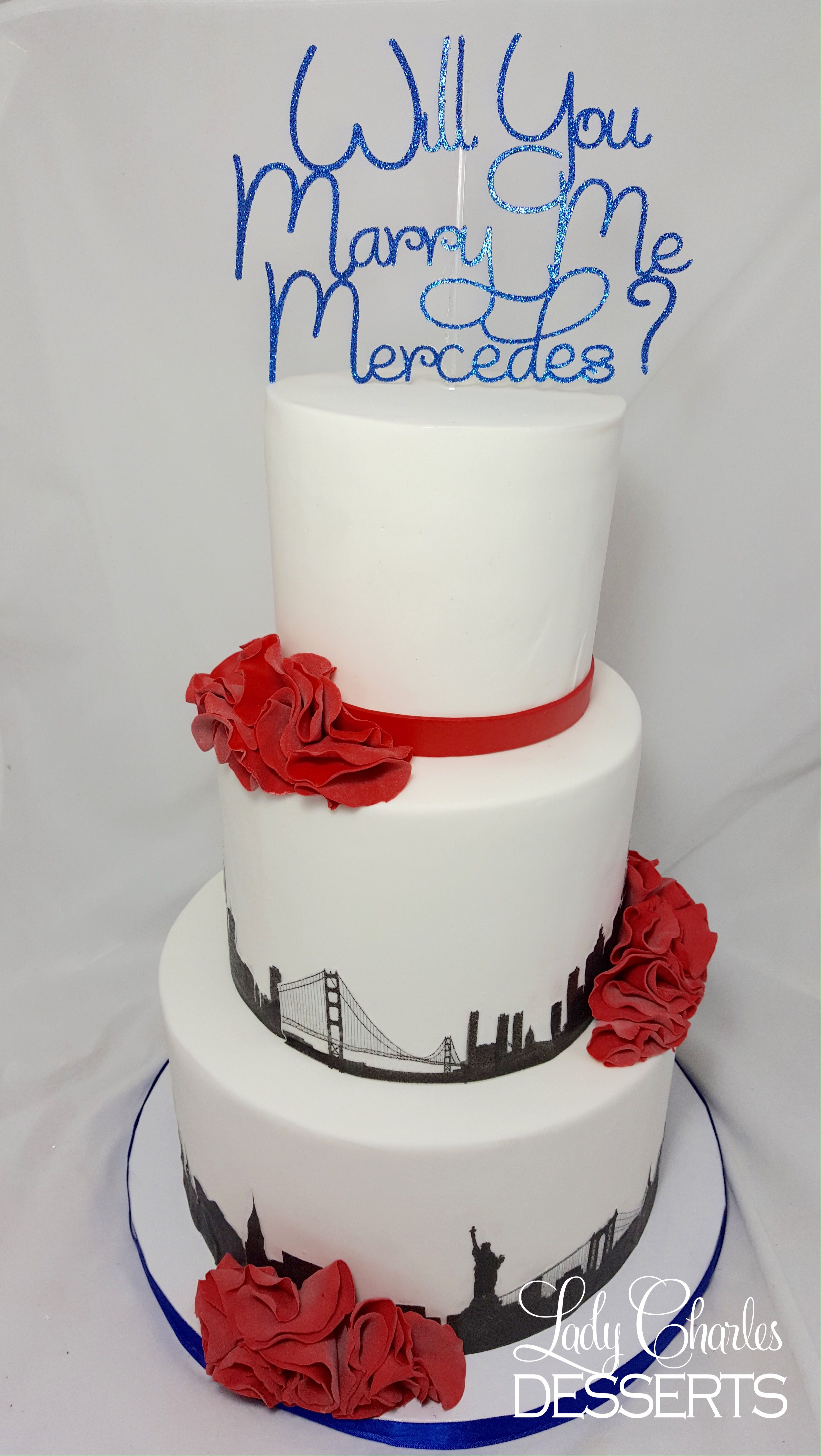 She said yes! This San Francisco and New York City skyline going away cake doubled as a wedding proposal cake when the surprise top tier was added.