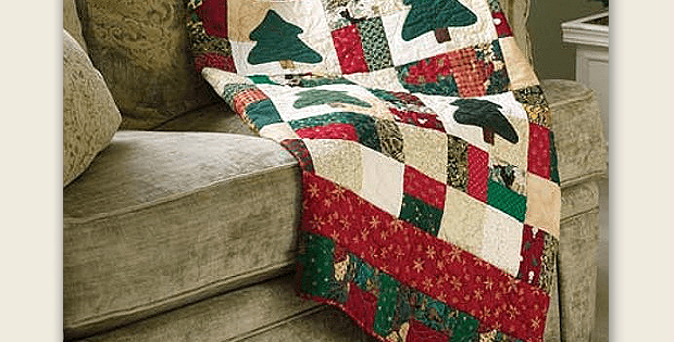 Quick, Easy and a Great Use of Scraps! This charming quilt is the perfect project for using up leftover Christmas fabric. Easy piecing and simple fusible applique mean you'll have this done before you know it. The body of the quilt goes together quickly from large squares of fabric. The applique trees make the quilt …