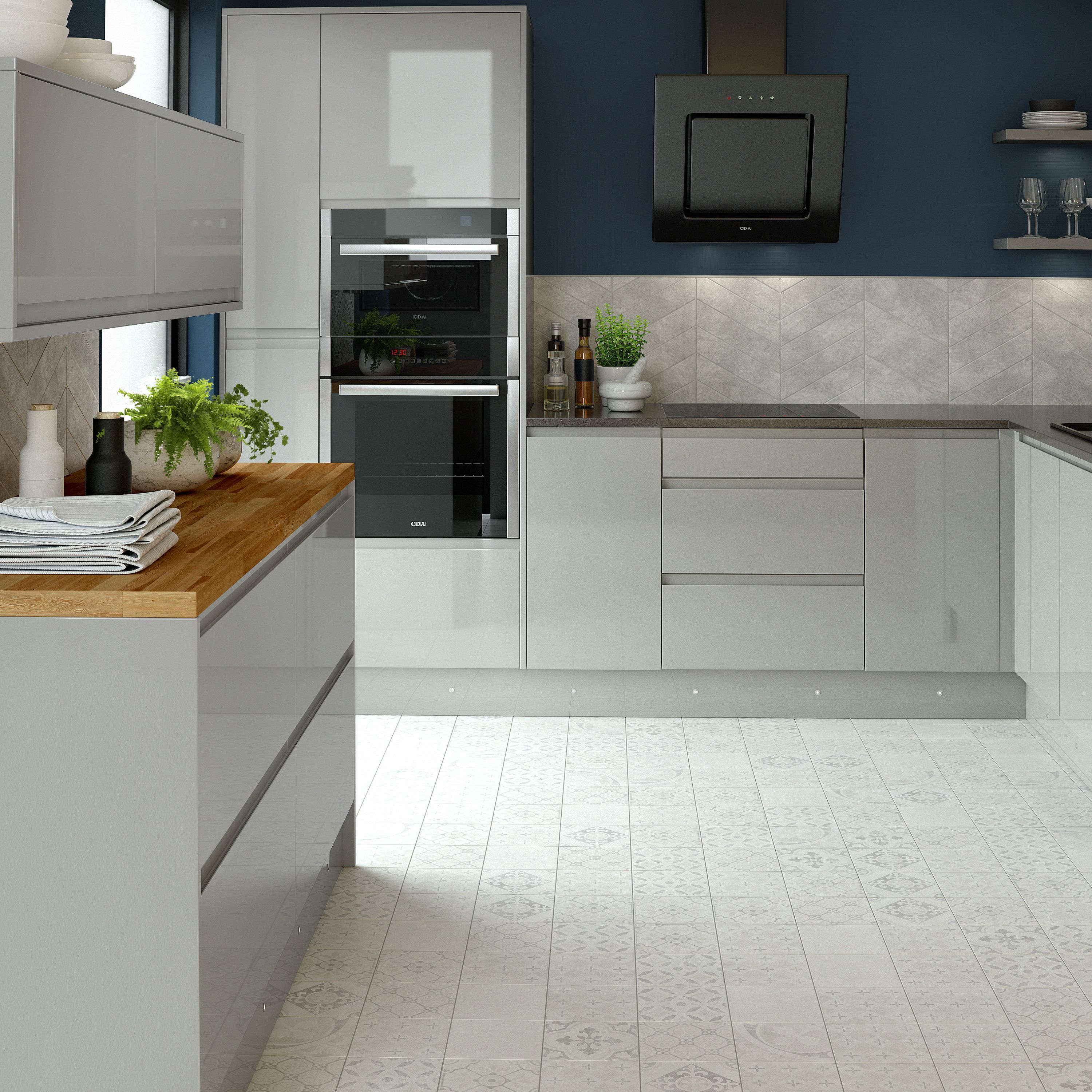 Modern kitchen with gloss handleless doors. Fitted with