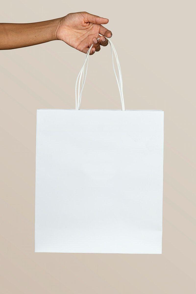Download Download Premium Illustration Of Black Woman Holding A White Paper Bag In 2020 Bag Mockup Paper Bag Paper Bag Design