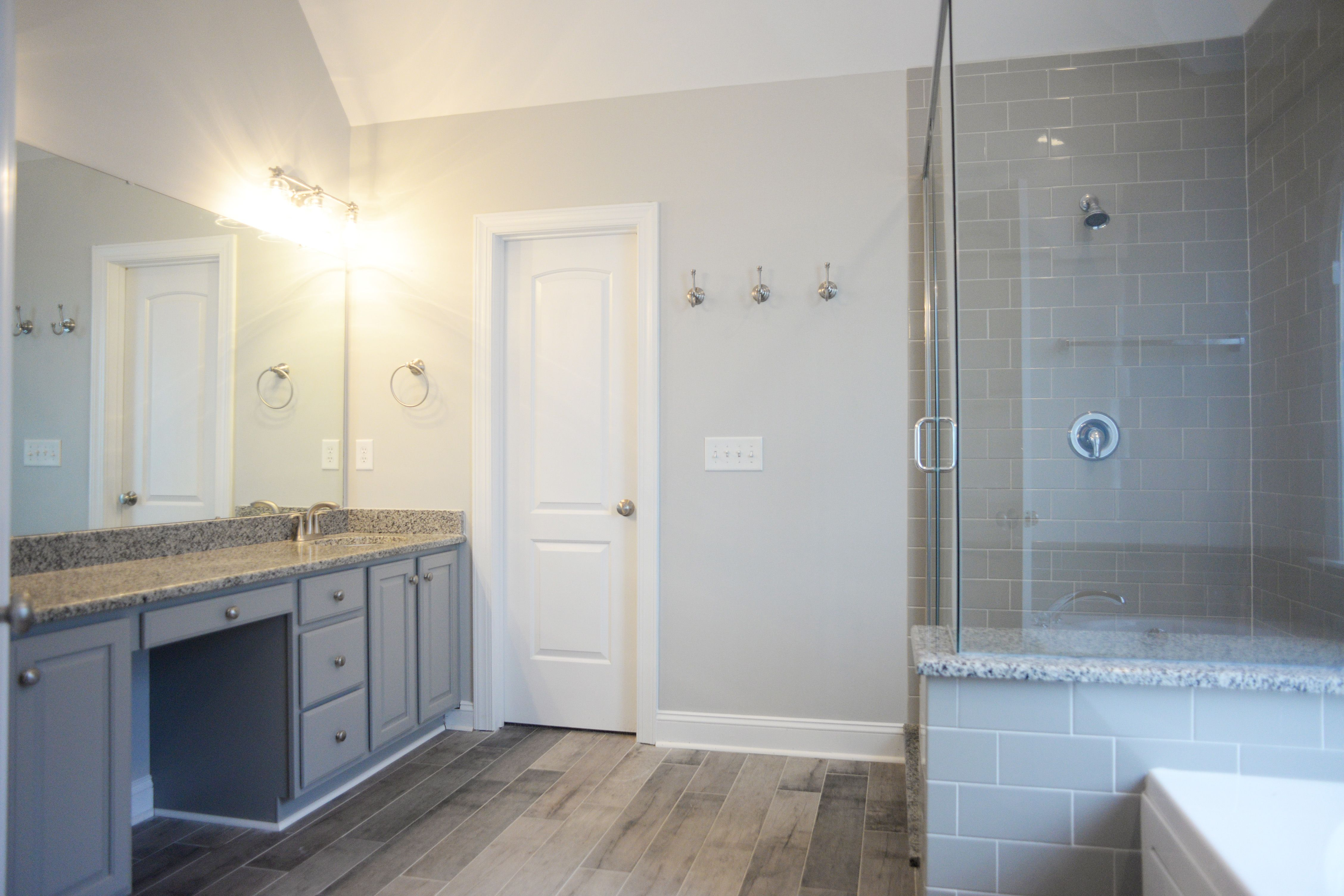 master bathroom renovation; gray bathroom, subway tile shower, wood ...