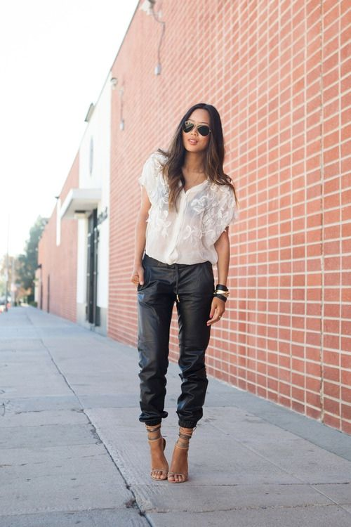 Leather pants and a romantic top.