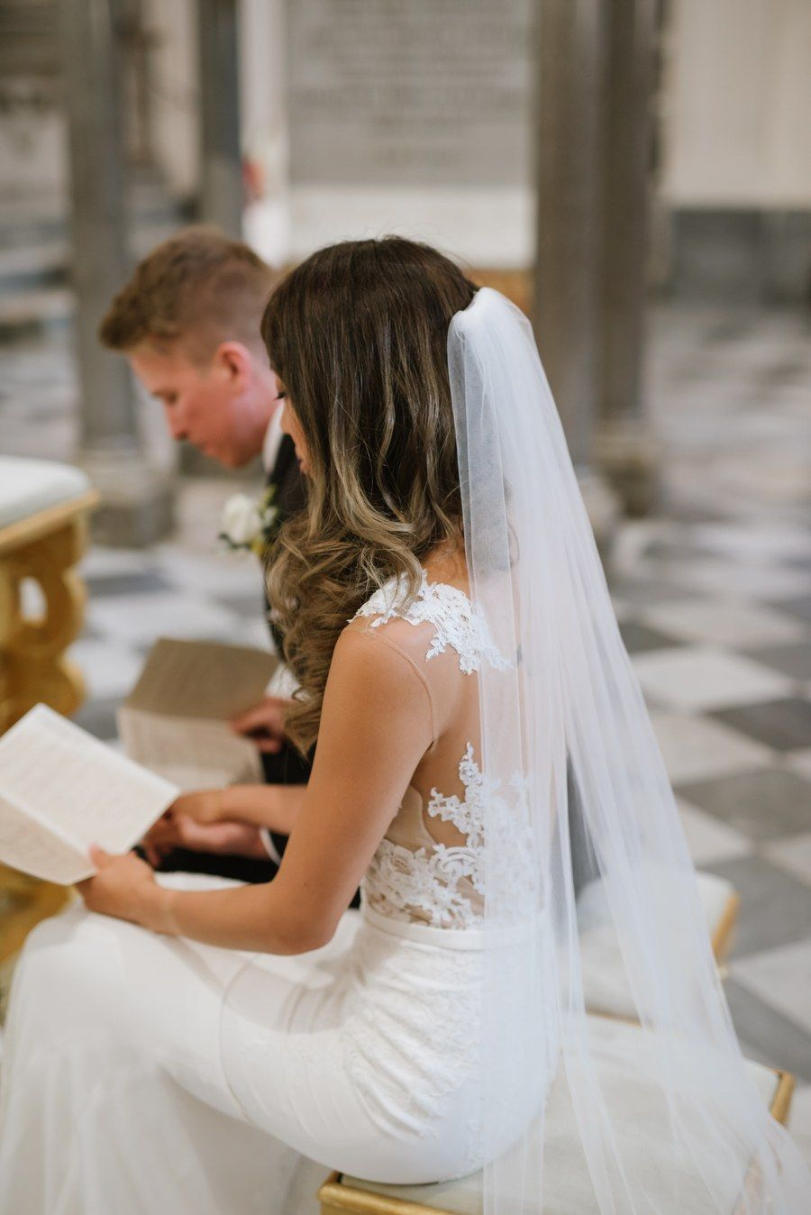 Bride reading pamphlet during ceremony hawaii wedding hair