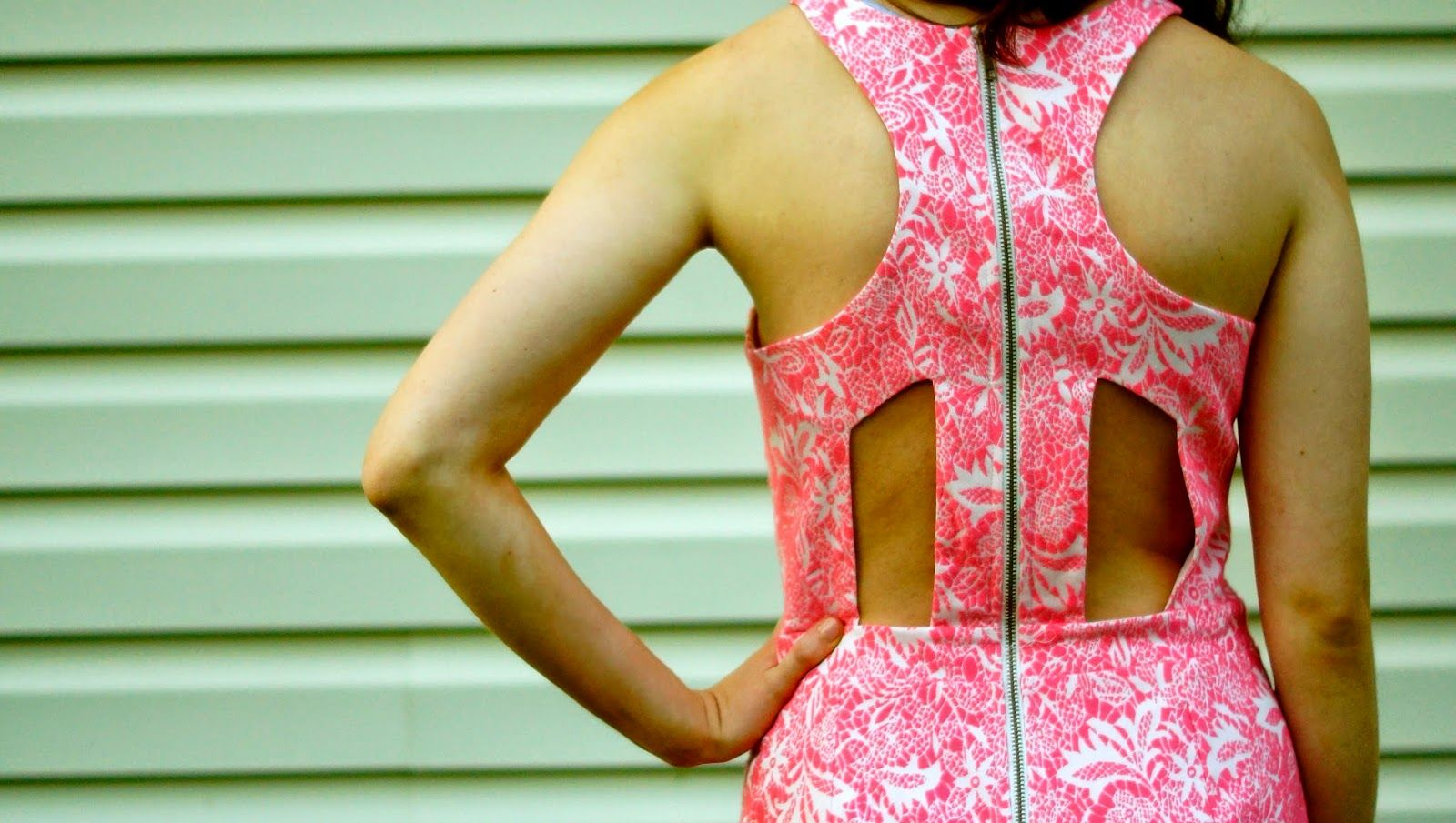 Katie from OneLittleBlackBlog looks stunning in her Sugar Lips dress with cutouts from #9thandelm!