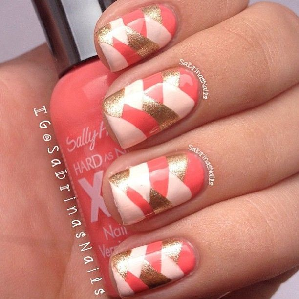 Golden and coral nail art