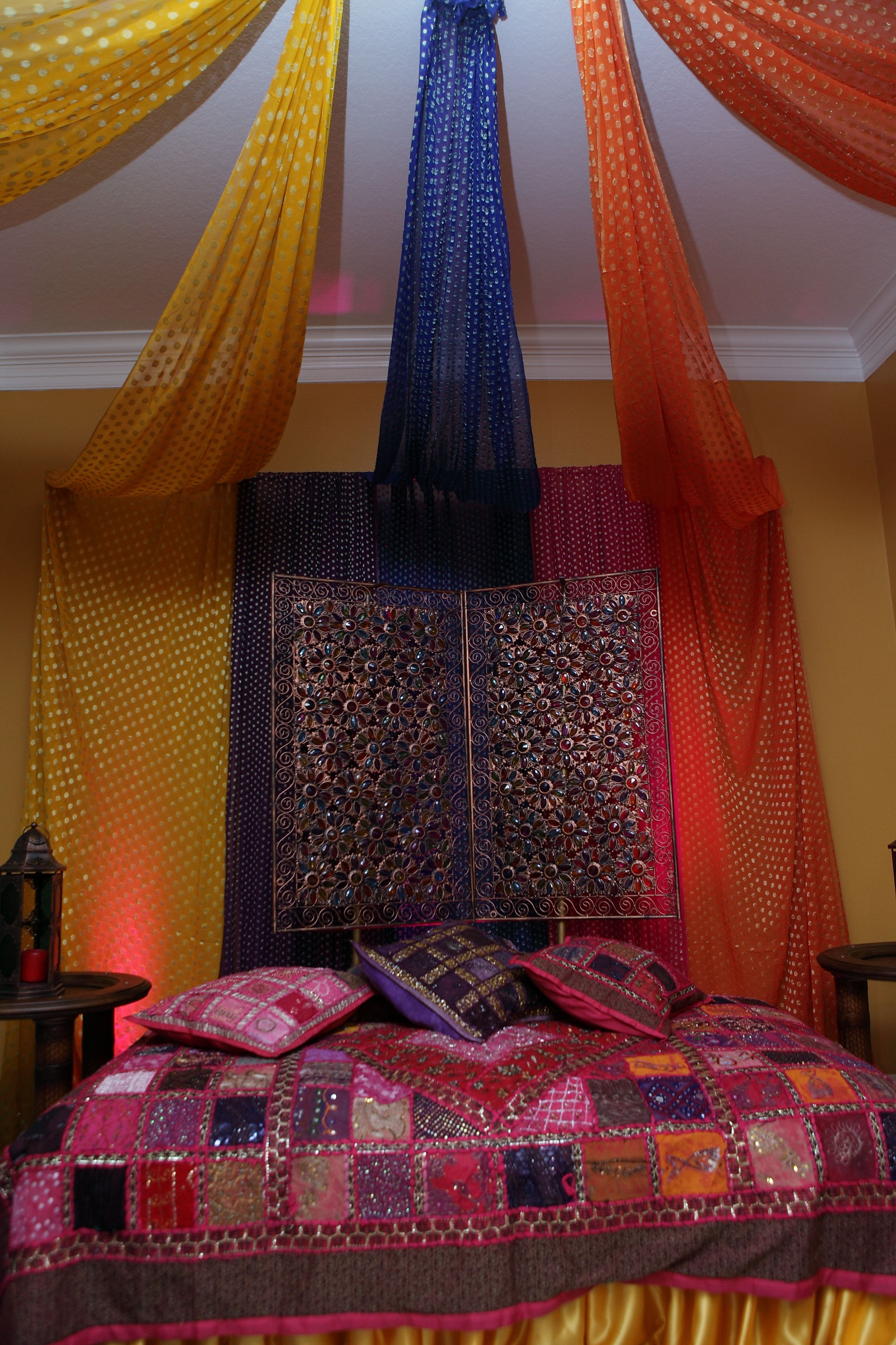Mehndi Flower Dupatta : Use the fan and existing curtain rods to support saree