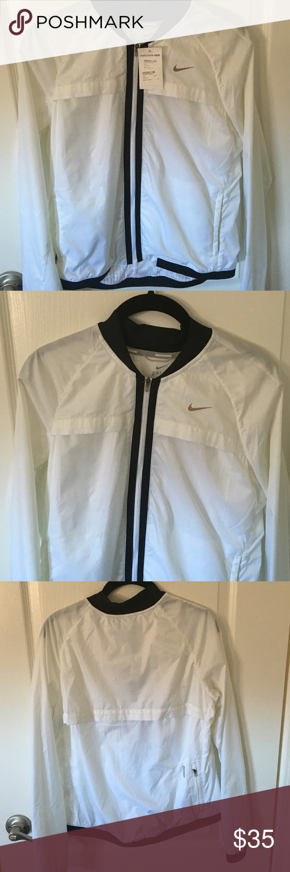 White Nike Running Jacket Brand new white Nike running jacket Nike Jackets & Coats