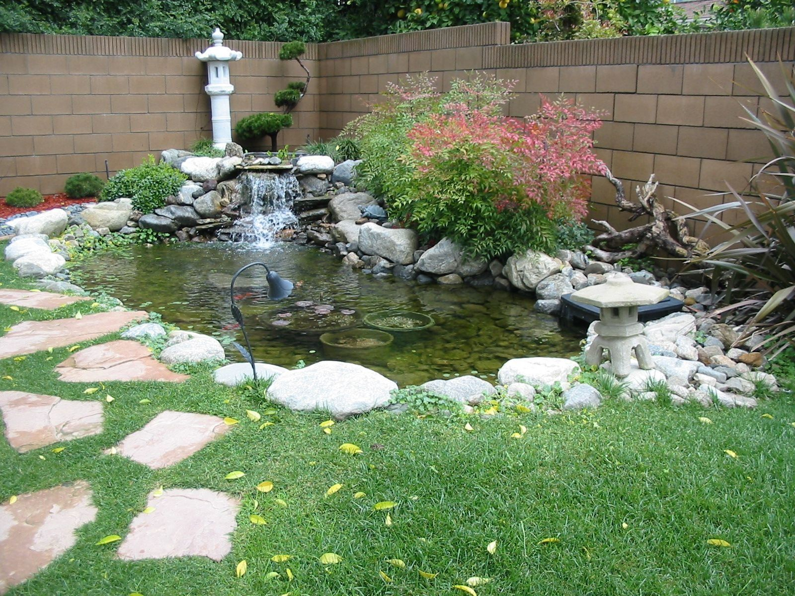 Small Garden With Mini Japanese Ornament And Pond