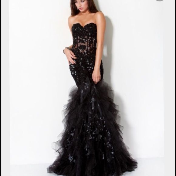 Black Jovani dress Not the best pictures but it really is a beautiful dress. Size 6 no alterations! Brand is jovani. Only worn once. Will take reasonable offers. Jovani Dresses Strapless