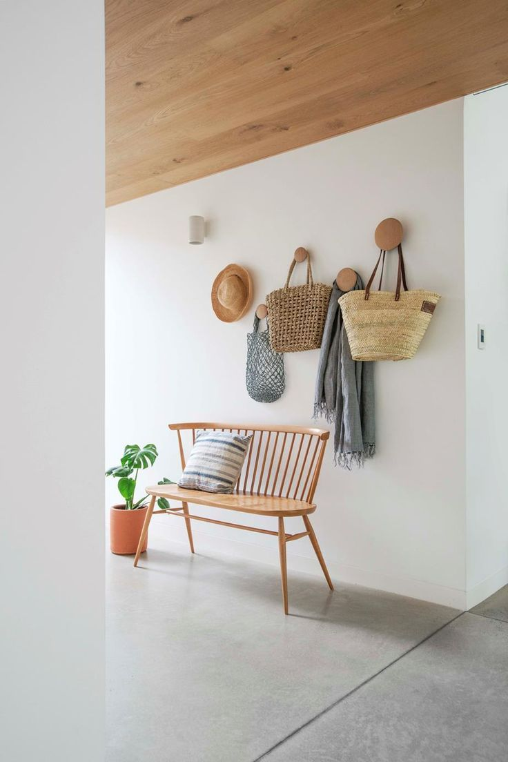 The owners of this Adelaide home hired a Scandinavian architect to design a modern 'cabin' around a lilly pilly tree in their garden. #entryway #modernhome