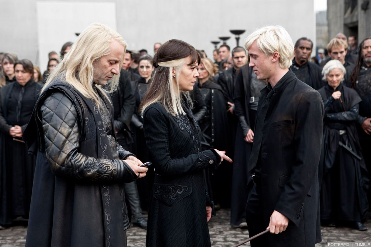 What?!! Lucius using a muggle phone! XD LoL, it's behind the