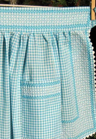 Embroidering on gingham apron