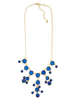 Cleavage-grazing blue baubles (eyes up here, everyone!). Goldtone necklace, $17.99; overstock.com.