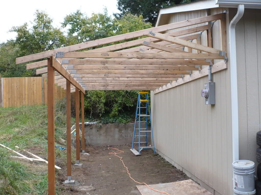 Patio off of the garage pictures trusses from the back for Lean to house designs