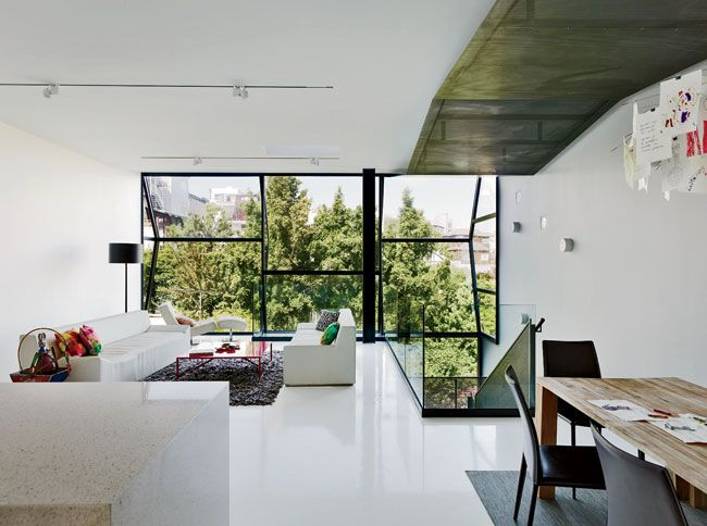 Flip House Fougeron Architecture San Francisco Vertical strips of field glazing— bonded to the frames on site—bring light and views to the living area on the second floor