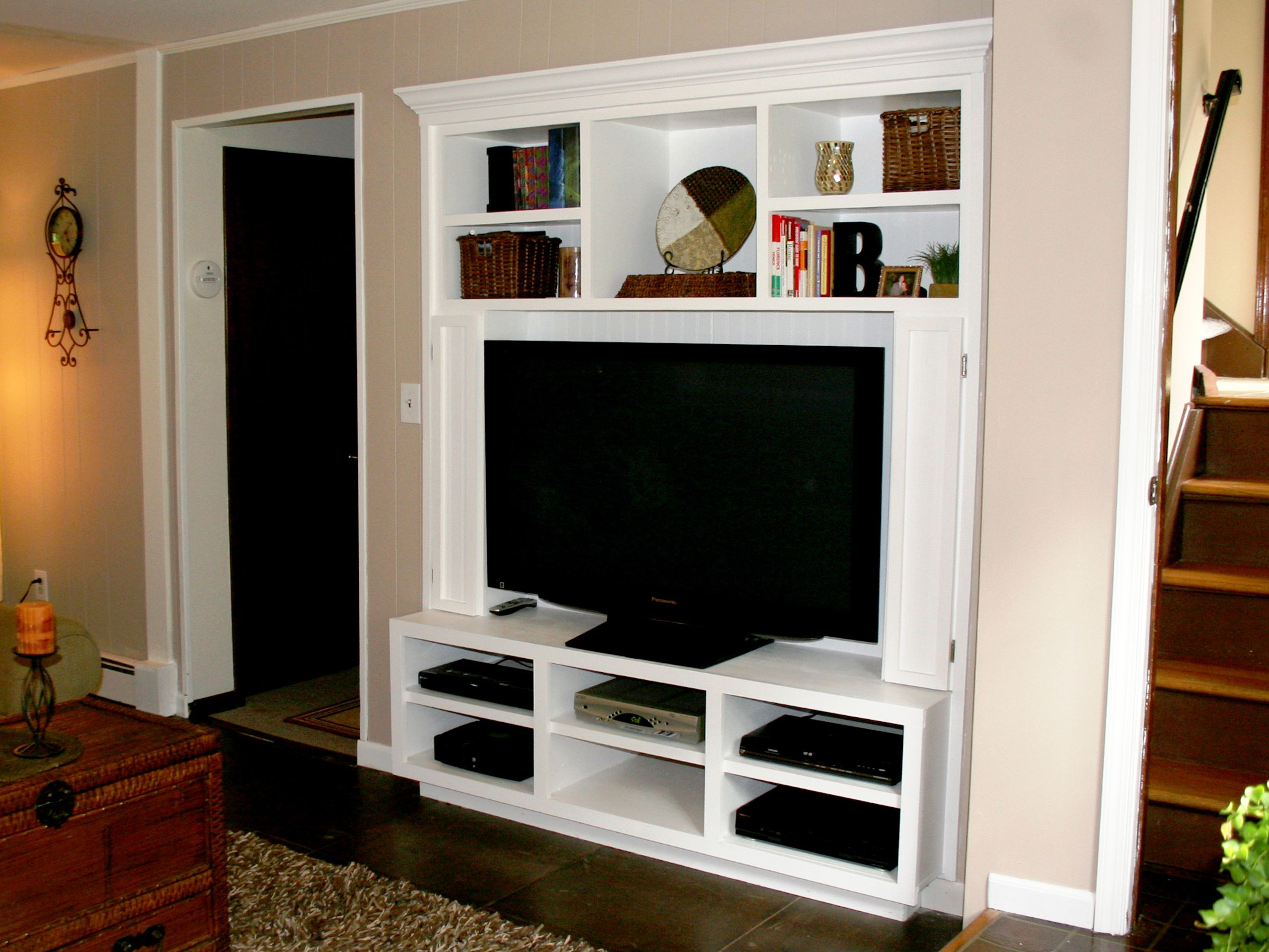 Built In Entertainment Center To Maximize Storage Space