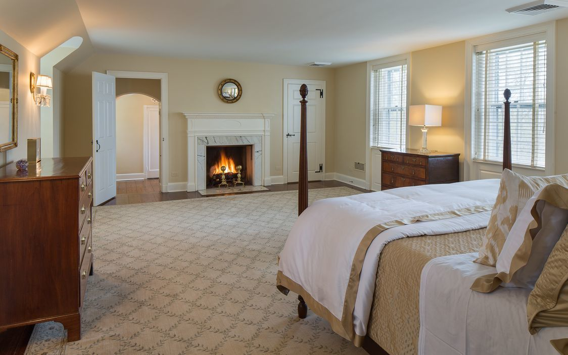 Master suite with step-down dressing galley, white marble steam shower with seven shower heads.