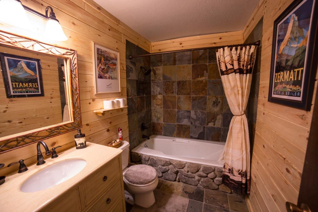 This is the washroom off the main hallway we used 12x12 for Rustic cabin flooring
