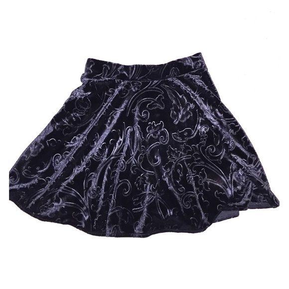 Black velvet skater skirt -not tight fitting -black designs -size small -very comfortable Forever 21 Skirts Circle & Skater