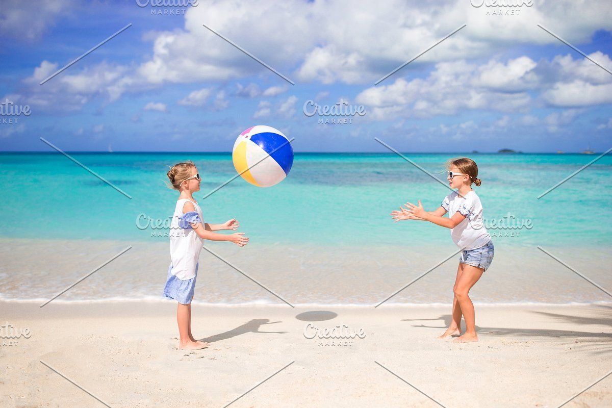 Little Adorable Girls Playing With Ball On The Beach Kids Having Fun On The Seashore In 2020 Girls Play Beach Kids Adorable