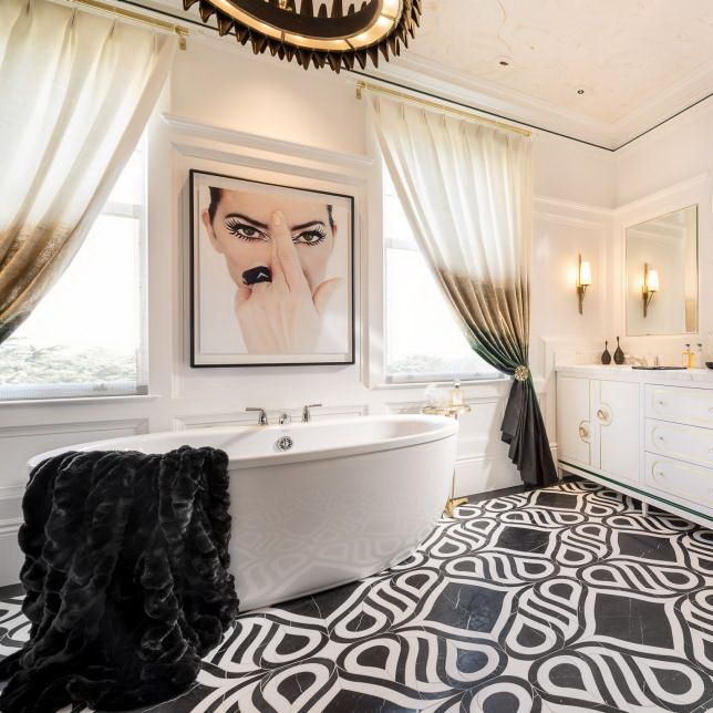 Inspired by 1960s fashion, designer Tineke Triggs created a luxurious retreat for the woman of the home in the En Vogue Salon at the San Francisco Decorator Showcase 2015. Designed around artwork that mimics a cover of Vogue magazine from the era, the bathroom features tile meant to mimic the curves of a couture Givenchy gown, a vanity with brass inlay and a crown-like chandelier.