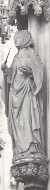 Lucia van Syracuse - 1895. Beeldhouwwerk door H. van der Geld. Nederland, Den Bosch, St-Janskathedraal.