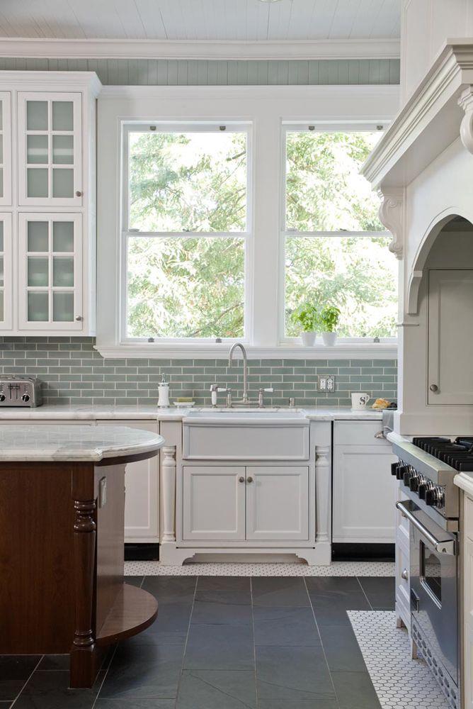 Kitchen with white cabinets aqua beadboard walls and aqua subway