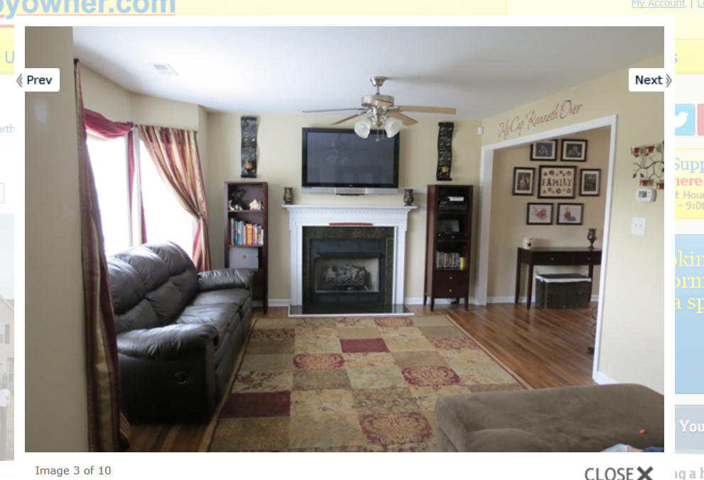 living room area, white fireplace , bay window, lots of ...