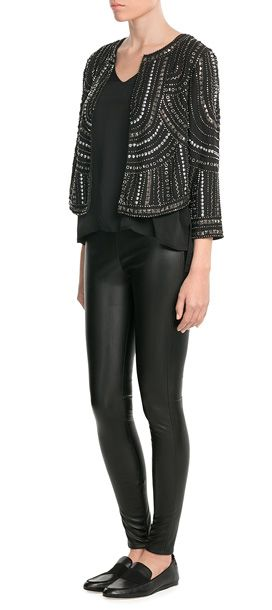 The easiest way to breathe texture and flair into any look is with this embellished jacket from Velvet. Mixed metal studs and a boxy silhouette are made easy to style in classic black #Stylebop